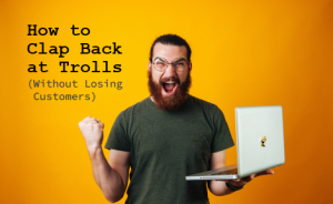 "angry man holding a laptop with text overlaid that says ""How to Clap Back at Trolls (Without Losing Customers)"""
