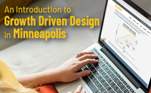 "a hand typing on a macbook with text overlaid that says ""An Introduction to Growth-Driven Design in Minneapolis"""