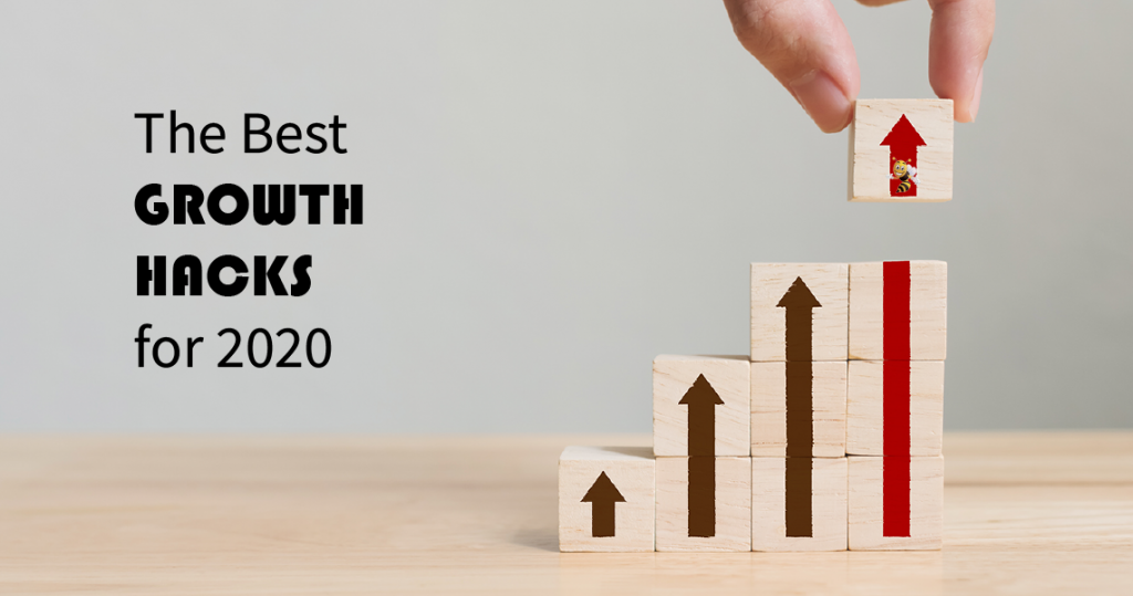 "bricks with painted arrows with text overlaid that says ""The Best Growth Hacks for 2020"""