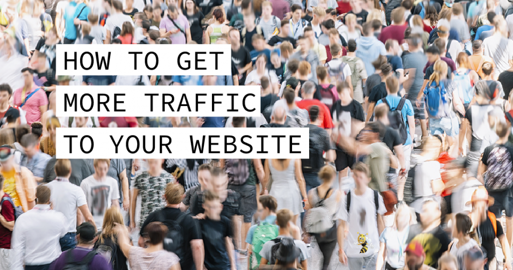 """people in a crowd with text overlaid that says """"How to Get More Traffic to Your Website"""""""