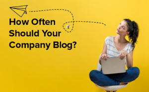 """a woman holding a laptop, with text overlaid that says """"How Often Should Your Company Blog?"""""""