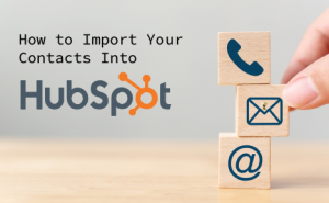 "a stack of 3 building blocks with a phone, envelope, and @ icon. text overlaid says ""How to Import Your Contacts Into HubSpot's CRM"""