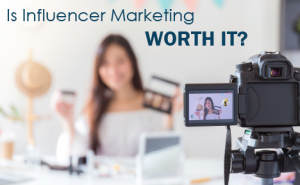 "a woman holding makeup in front of a filming camera, with text overlaid that says ""is influencer marketing worth it?"""