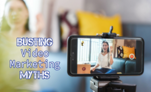"a cellphone recording a video of a woman talking with text overlaid that says ""Busting Video Marketing Myths"""