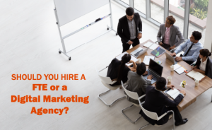 """a group of employees in a meeting room with text overlaid that says """"Should You Hire a FTE or a Digital Marketing Agency?"""""""
